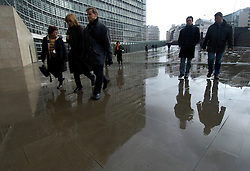 BRUSSELS, BELGIUM - FEB-9-2004 - Employees and visitors make their way to and from the Berlaymont building, the headquarters of the European Commission. (PHOTO © JOCK FISTICK)