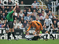 Photo. Andrew Unwin.<br /> Newcastle United v Wolverhampton Wanderers, FA Barclaycard Premier League, St James Park, Newcastle upon Tyne 09/05/2004.<br /> Wolves' Colin Cameron (r) receives a yellow card for a challenge that leaves Newcastle's Lee Bowyer (c) on the floor.