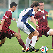 UNCW's Kalvin Kromer is challenged by Winthrop defenders. (Jason A. Frizzelle)