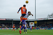 Scunthorpe United midfielder Duane Holmes (19) towers above Rotherham United Defender Joe Mattock (3) to head the ball during the EFL Sky Bet League 1 match between Scunthorpe United and Rotherham United at Glanford Park, Scunthorpe, England on 10 February 2018. Picture by Craig Zadoroznyj.