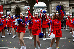 © Licensed to London News Pictures. 01/01/2020. London, UK. Cheerleaders at the New Year's Day Parade in central London. Over 10,000 performers representing the London boroughs and countries from across the globe are parading from Piccadilly Circus to Parliament Square as tens of thousands of Londoners and tourists line the route. Every year, dancers, acrobats, cheerleaders, marching bands, historic vehicles and more assemble in the heart of the capital for a colourful celebration of contemporary performances and traditional pomp and ceremony. Photo credit: Dinendra Haria/LNP