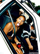 Girl sitting in a car sticking out her tongue, Ibiza 1998