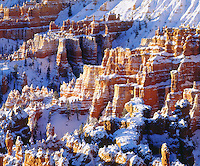 I hiked through deep snow and set up 4x5 view camera to photograph Bryce Canyon in winter.  I waited for  these spectacular sandstone formations covered in snow to light up and glow against the shadows from the hoodoos before I took my picture.