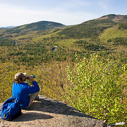 A hiker on the Boulder Loop Trail in New Hampshire's White Mountains.  White Mountain National Forest.