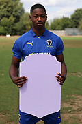 AFC Wimbledon midfielder Osaze Urhoghide (37) holding Fifa sign during the AFC Wimbledon 2018/19 official photocall at the Kings Sports Ground, New Malden, United Kingdom on 31 July 2018. Picture by Matthew Redman.