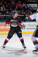 KELOWNA, CANADA -FEBRUARY 25: Aaron Macklin #11 of the Prince George Cougars drops the gloves against the Kelowna Rockets on February 25, 2014 at Prospera Place in Kelowna, British Columbia, Canada.   (Photo by Marissa Baecker/Getty Images)  *** Local Caption *** Aaron Macklin;