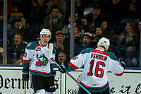 KELOWNA, CANADA - JANUARY 4: Michael Farren #16 and Conner Bruggen-Cate #20 of the Kelowna Rockets celebrate a second period goal against the Prince George Cougars on January 4, 2019 at Prospera Place in Kelowna, British Columbia, Canada.  (Photo by Marissa Baecker/Shoot the Breeze)