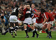 Paul O'Connell (Captain) of the Lions is forced out of play by Keegan Daniel and Lwazi Mvovo of the Sharks. Adam Jones of the Lions is trying to stop them.<br /> Rugby - 090610 - British&Irish Lions v Sharks - ABSA Stadium - Durban - South Africa. The Lions won 37 -3.<br /> Photographer : Anton de Villiers / SASPA