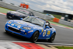 Luke Herbert takes Kevin Taylor at The Esses on the Snetterton 200 circuit.
