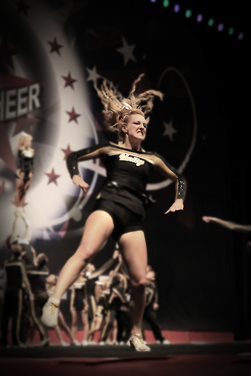 A Unity Allstars Cheerleader on SOCO6, Unity Black, finishing her tumble, looking fierce!