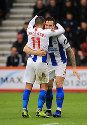 Brighton & Hove Albion's Anthony Knockaert (left) and Shane Duffy (right) celebrates their side's third goal of the game during the Emirates FA Cup, third round match at the Vitality Stadium, Bournemouth.