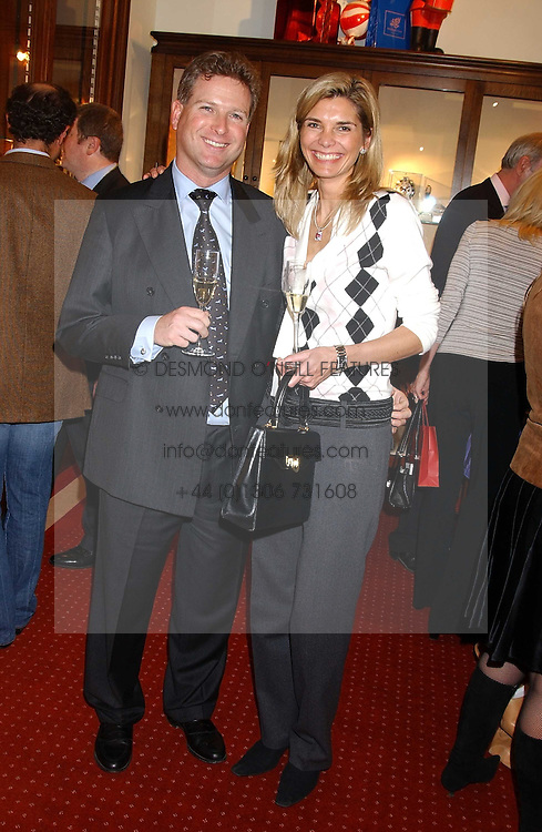 WILLIAM & LUCY ASPREY at a drinks party for the Game Conservancy Trust's committee held at Williams & Son, 10 Mount Street, London WlK hosted by Willaim & Lucy Asprey on 6th December 2005.<br />