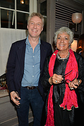 Tate Archivist ADRIAN GLEW and GEMMA LEVINE at a party to celebrate the publication on 'Just One More - A Photographers Memoir' by Gemma Levine held at 34, South Audley Street, London on 7th April 2014.