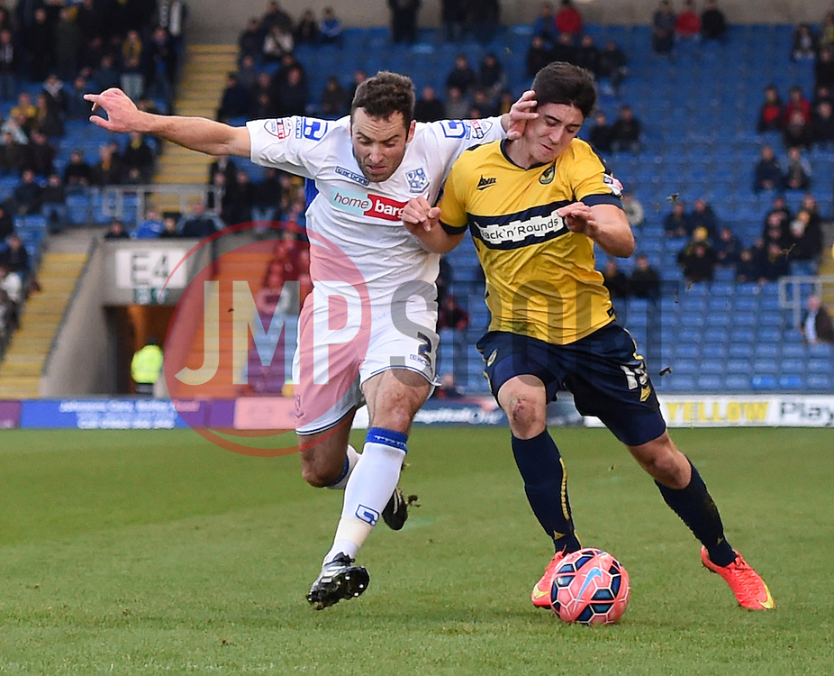 Tranmere Rovers' Danny Holmes challenges Oxford United's Callum O'Dowda - Photo mandatory by-line: Paul Knight/JMP - Mobile: 07966 386802 - 06/12/2014 - SPORT - Football - Oxford - Kassam Stadium - Oxford United v Tranmere Rovers - FA Cup Second Round