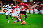 Exeter City's Jamie Reid is tacked by Port Vale's Remie Streete during the The FA Cup match between Exeter City and Port Vale at St James' Park, Exeter, England on 6 December 2015. Photo by Graham Hunt.