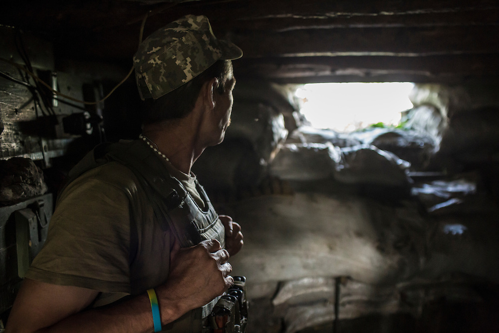 AVDIIVKA, UKRAINE - JULY 9, 2016: A Ukrainian soldier in a front-line bunker in Avdiivka, Ukraine. The town is now one of the most active areas of fighting along the line of control between the Ukrainian government and Russian-backed rebels. CREDIT: Brendan Hoffman for The New York Times