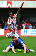 Mathieu Manset fouls Mark Ellis during the Sky Bet League 2 match between Cheltenham Town and Shrewsbury Town at Whaddon Road, Cheltenham, England on 25 April 2015. Photo by Alan Franklin.