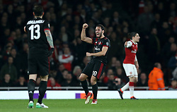 AC Milan's Hakan Calhanoglu (centre) celebrates scoring his side's first goal of the game during the UEFA Europa League round of 16, second leg match at the Emirates Stadium, London.