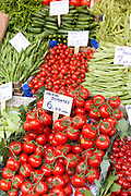 Fresh vegetables tomatoes peas, beans, for sale at food and spice market in Kadikoy district on Asian side Istanbul, East Turkey