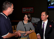 (from right) Kettering Council Candidate Nolan Thomas and Meghan Cole during an election night party at Buffalo Wild Wings in the Town & Country Shopping Center in Kettering, Tuesday, November 8, 2011..