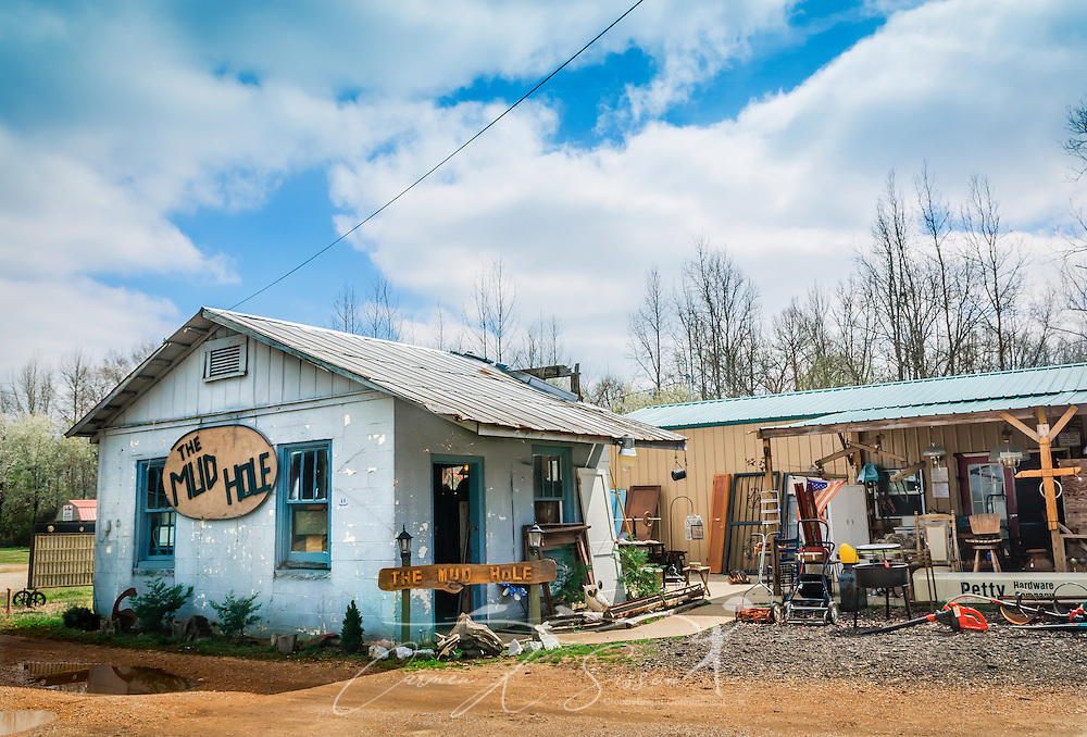 The Mud Hole is a thrift store along Highway 82 in Reform, Alabama. The business, owned by Jeanne and Robbie Epperson, carries an eclectic assortment of trinkets and treasures, from glass door knobs to wagon wheels — along with red worms and night crawlers for area fishermen. (Photo by Carmen K. Sisson/Cloudybright)