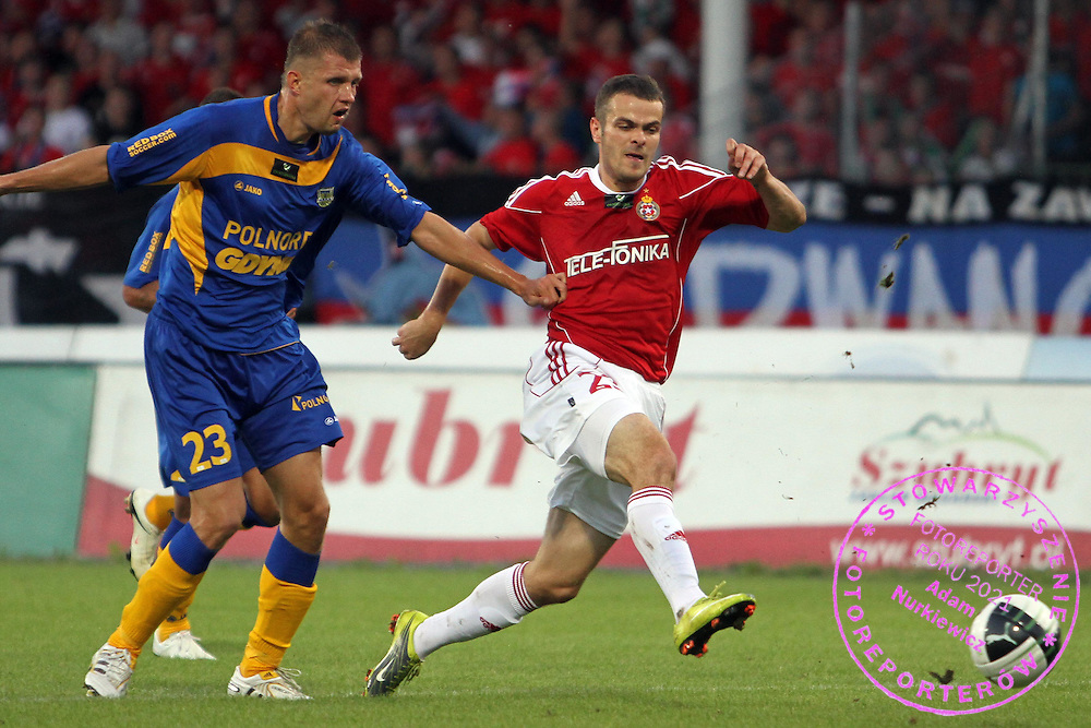 STADION HUTNIKA , MECZ EKSTRAKLASY PILKI NOZNEJ WISLA KRAKOW - ARKA GDYNIA , N/Z  PAWEL  BROZEK WISLA, SZMATIUK MACIEJ ARKA....KRAKOW , POLSKA , SIERPIEN 08 , 2010....( PHOTO BY NORBERT KROL / MEDIASPORT )....PICTURE ALSO AVAIBLE IN RAW OR TIFF FORMAT ON SPECIAL REQUEST.  *** Local Caption *** `