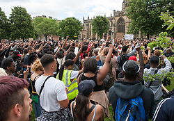 © Licensed to London News Pictures.10/07/2016. Bristol, UK.  The crowd give a salute at a Black Lives Matter march through Bristol from St Pauls to College Green, following the killings of black men in the USA. Photo credit : Simon Chapman/LNP