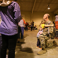 Maj. William Anderson of Ponotoc gets big hug from his granddaughter, Forrest Burton, 5, one last hug before he boards a bus with the rest of the members of the 155th Headquarters Headquarters Company as they leave for training at Fort Bliss. After training the entire 155th Brigade ombat Team will delpoy to various parts of the Middle East.