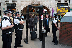 © licensed to London News Pictures. London, UK. 20/07/12. Police knife-arch set up outside the station. Pictures show Victoria station yesterday where an increased police presence was visible in the run up to the London 2012 Olympic Games. Officers from the Metropolitan & British Transport Police conducted searches and patrols in conjunction with the Royal Military Police in the area. Photo credit: Jules Mattsson/LNP