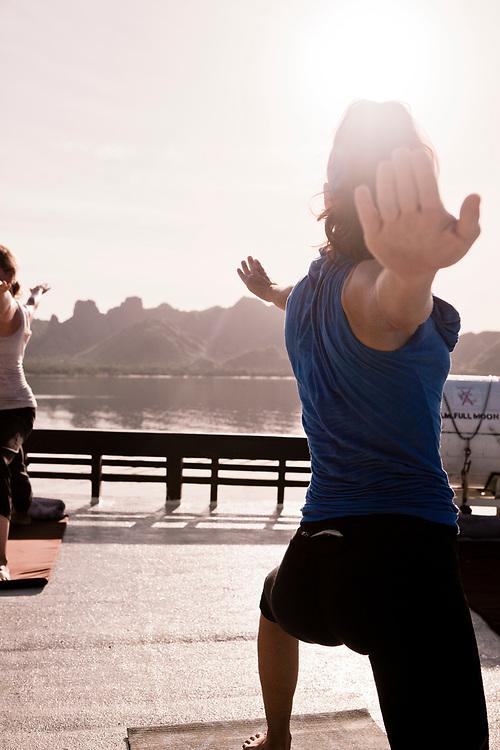 Morning yoga on top deck of Alila Purnama.