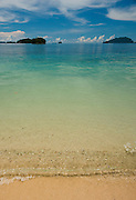 Swash zone on white sand beach, Um Brom Island, Triton Bay, Papua