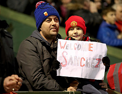 A young Manchester United fan holds up a 'Welcome Sanchez' sign in the stands during the Emirates FA Cup, fourth round match at Huish Park, Yeovil.