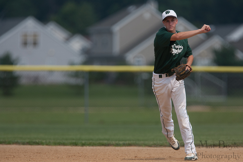 West Deptford's Chris Dillaquilla throws the runner out at first during a elimination bracket game of the Eastern Regional Senior League tournament held in West Deptford on Sunday, August 7.
