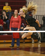 Solon's Jordan Smith (12) is pumped up after a score during the WaMaC Tournament semifinal game at Mount Vernon High School in Mount Vernon on Thursday October 11, 2012. Solon defeated Mount Vernon 26-24, 25-22.