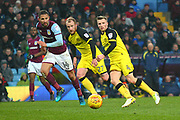 Burton Albion's Jamie Allen passes as Burton Albion's Liam Boyce and Aston Villa's Conor Hourihane look on during the EFL Sky Bet Championship match between Aston Villa and Burton Albion at Villa Park, Birmingham, England on 3 February 2018. Picture by John Potts.