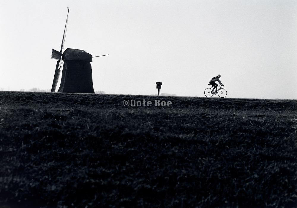 Someone biking in silhouette