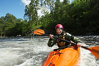 Woman kayaking in river portrait