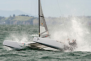 Peter Burling (NZL275) approaching the top mark in race six of the A Class World championships regatta being sailed at Takapuna in Auckland. 13/2/2014