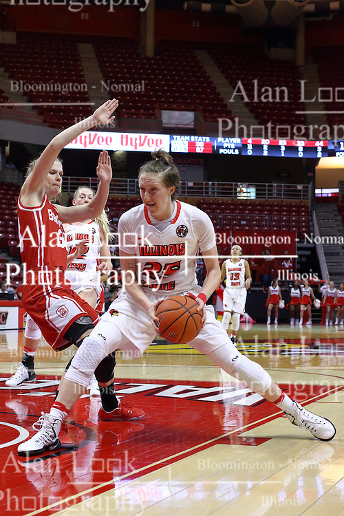 01 January 2017: Anneke Schlueter stumbles backwards as Hannah Green moves hard to the hoop during an NCAA Missouri Valley Conference Women's Basketball game between Illinois State University Redbirds the Braves of Bradley at Redbird Arena in Normal Illinois.