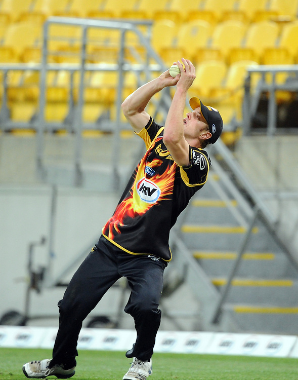 Wellington Firebirds Michael Pollard takes a catch on the boundary to dismiss Auckland Aces Gareth Hopkins in the HRV T20 cricket match at Westpac Stadium, Wellington, New Zealand, Saturday, November 23, 2013. Credit:SNPA / Ross Setford
