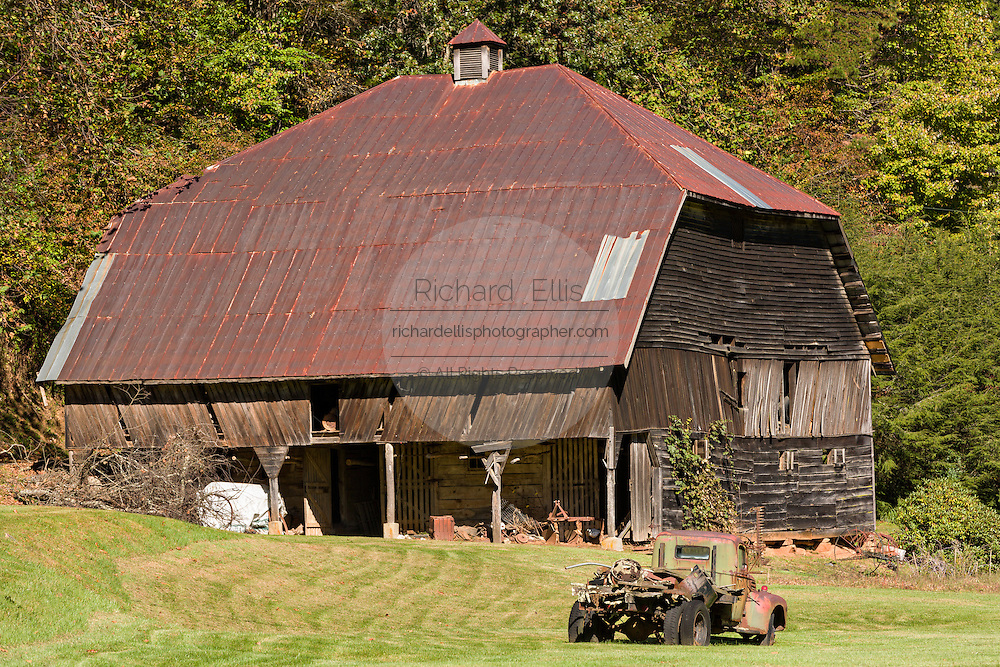 An old wooden barn in a farm field in Prices Creek, North Carolina.