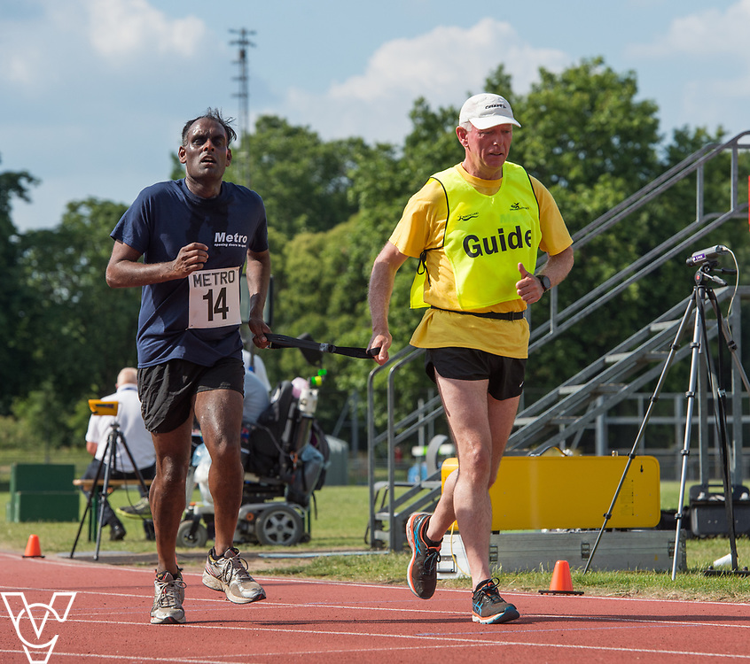 Metro Blind Sport's 2017 Athletics Open held at Mile End Stadium.  5000m.  Competitor #14 with guide runner<br /> <br /> Picture: Chris Vaughan Photography for Metro Blind Sport<br /> Date: June 17, 2017
