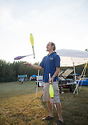 Robby Ryan, who was working at the Dovetail Solar and Wind booth, juggles at the Pawpaw Festival on Sept. 16, 2016.