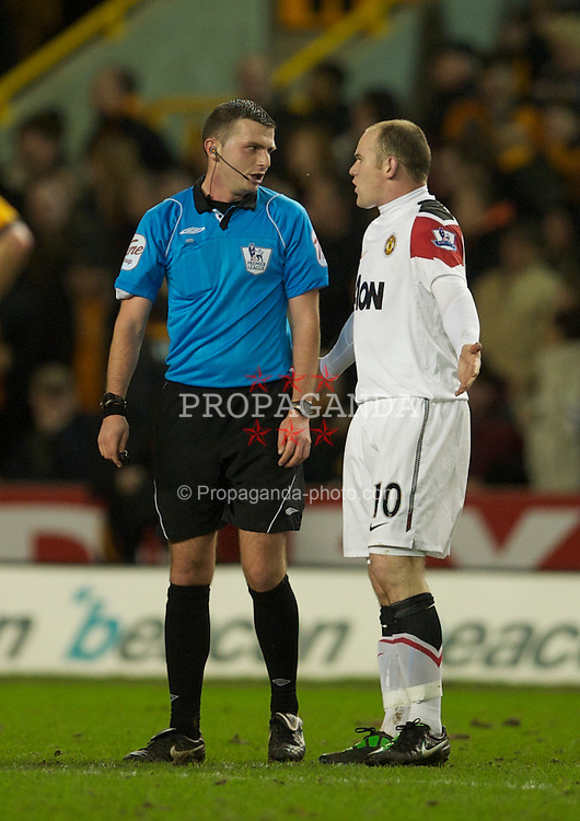WOLVERHAMPTON, ENGLAND - Saturday, February 5, 2011: Manchester United's Wayne Rooney complains to referee Michael Oliver after Wolverhampton Wanderers' second goal during the Premiership match at Molineux. (Photo by David Rawcliffe/Propaganda)