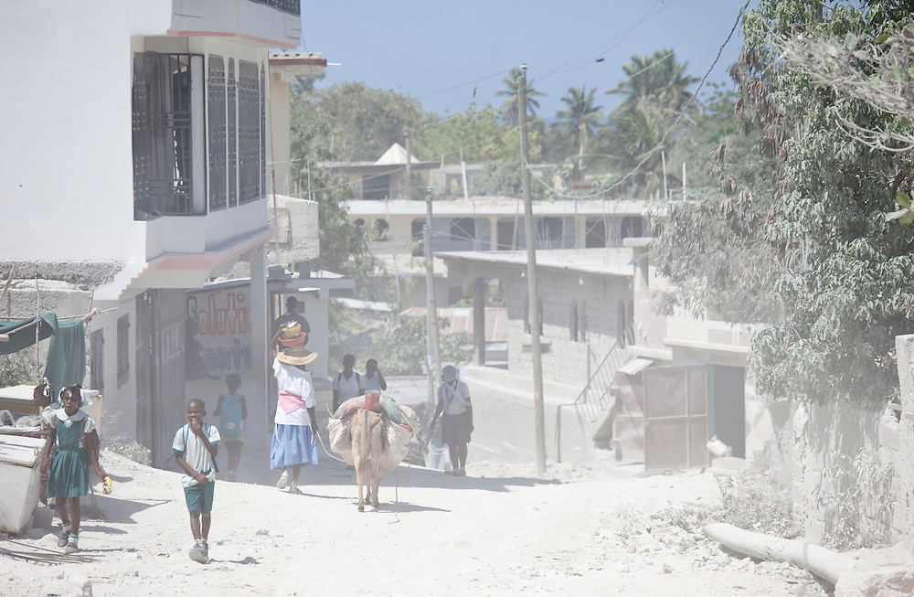 Dust fills the air on a street in Anse a Galet, Ile de La Gonave, Haiti