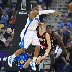 02 February 2009: New Orleans Hornets guard Chris Paul (3) passes the ball as Portland Trailblazers' Sergio Rodriguez (11) defends during a 97-89 loss by the New Orleans Hornets to the Portland Trail Blazers at the New Orleans Arena in New Orleans, LA.