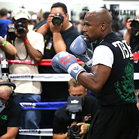 LAS VEGAS, NV - APRIL 14: WBC/WBA welterweight champion Floyd Mayweather Jr. (R) works out with his uncle Roger Mayweather at the Mayweather Boxing Club on April 14, 2015 in Las Vegas, Nevada. Mayweather Jr. will face WBO welterweight champion Manny Pacquiao in a unification bout on May 2, 2015 in Las Vegas.  (Photo by Alex Menendez/Getty Images) *** Local Caption *** Floyd Mayweather Jr.