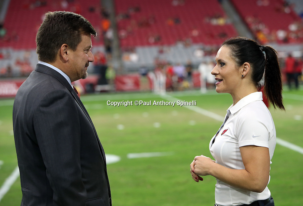 Arizona Cardinals team president Michael Bidwill talks to Arizona Cardinals coach Jen Welter, the first female coach in the NFL before the 2015 NFL preseason football game against the Kansas City Chiefs on Saturday, Aug. 15, 2015 in Glendale, Ariz. Welter's credentials include a phD and an MS in Sports Psychology. The Chiefs won the game 34-19. (©Paul Anthony Spinelli)