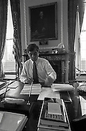 Massachusetts Governor Michael Dukakis catches up on paper work in his office the day following his victory in the New York Democratic presidential primary the day before.  He would gain the party's nomination but ultimately lose to George Bush in the 1888 Presidential election.