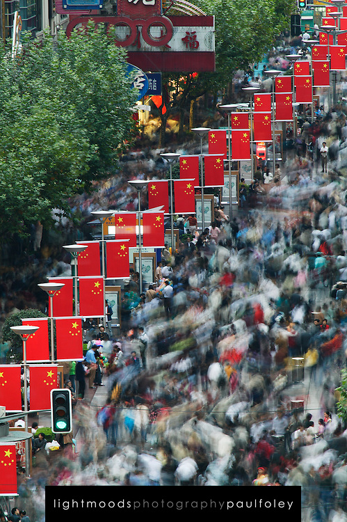 Man standing still in movement on Nanjing Donglu during Autumn Moon Festival, Shanghai, China